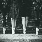 black and white of girls legs dance studio