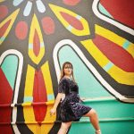 woodward dance girl in front of colorful mural