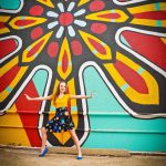 dance girl posing in front of colorful mural